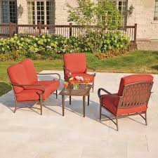 patio furnitures with black metal and cushions on the chairs