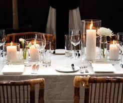 Pillar Candles In Thin Glass Hurricanes Enhance This Settings Minimal Rustic Decor