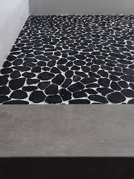 black white sliced pebble tile floor modern bathroom