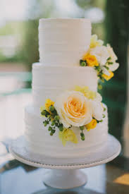 Simple white and yellow wedding cake roses berries spring