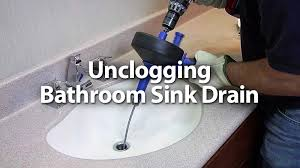 how to unclog a bathroom sink drain in the wall