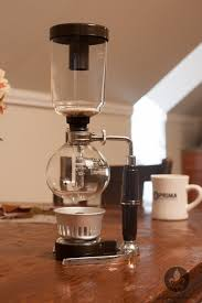 Syphon Vacuum Coffee Brewer With A Glass Top And Bottom As Well Butane Burner