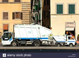 Large And Small Waste Disposal Trucks In Street, Florence, Italy ...
