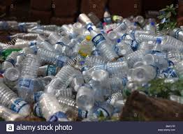 Waste Plastic Bottles Piled Up Behind A Beach In Goa India