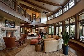 This Expansive Two Story Living Room Is Surrounded By Windows Highlighting The Broad Swaths Of