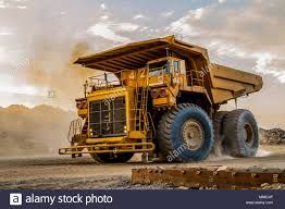 100 Large Dump Trucks Transporting Platinum Ore For Processing