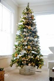 A Cute Galvanized Bucket Can Make Your Tree Bit Rustic