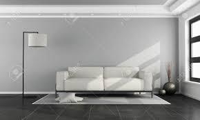 minimalistisches wohnzimmer mit weißem sofa grauer wand und schwarzem boden 3d rendering