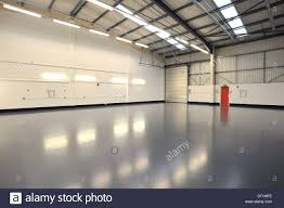 interior of empty and new warehouse with doors grey newly painted