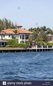 residence with barrel tile roof along intracoastal waterway in