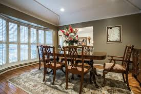 Stunning Details In This Formal Dining Room Bay Window With Plantation Shutters Tray
