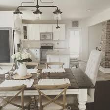 Rustic Modern Farmhouse With Table A Wood Top And White Cabinets On