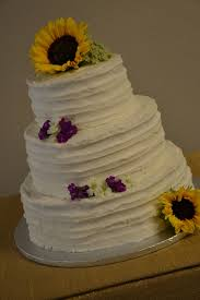 3 Tiered Rustic Wedding Cake With Sunflowers On Central