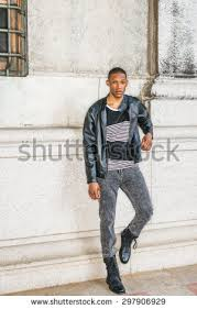Man Urban Casual Fashion Wearing Black Leather Jacket Striped Undershirt Jeans