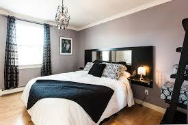 Contemporary Medium Tone Wood Floor Bedroom Idea In Other With Gray Walls