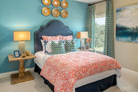 bedroom in teal and gold bedroom transitional with blue accent