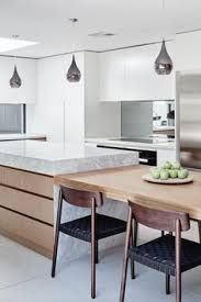 Featuring Custom Kitchen Joinery With Integrated Dining Table To The Island Benchtop Seating Large