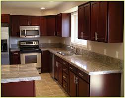 light granite countertops with cherry cabinets home design ideas