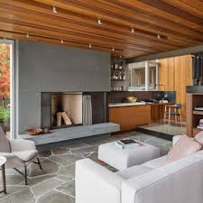 Example Of A Minimalist Open Concept Slate Floor Living Room Design In Seattle With Standard