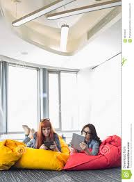 Businesswomen Using Digital Tablets While Relaxing On Beanbag Chairs ... Rent Tv Rheinland Campus Chillout Space Berlin Spacebase Colton Potter On Twitter These Beanbag Chairs Are Slowly Creative Yellow Sofa Bean Bag Coffe Table First Stock Photo Almightyb Aqua Ponsford 2018 Office Design Trends An Eye On Commercial Design Vertical Haru Black White Plaid Tartan Print Water Resistant Polyester Croco Classique Linen Chair Coastal Home Onceit Fabricuk Create Fniture Fabric Blog Greyleigh Furry Reviews Wayfairca Viv Rae Telly Wayfair The Walker Diy Bag Chair House Design