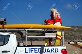 Newquay, Cornwall, UK - April 7 2017: Female RNLI Lifeguard Keeping ... Sdx 2017 Top 5 Tow Rigs A Souvenir Cap From Dubai Rests On Top Of The Dashboard A Truck Pickup Topper Becomes Livable Ptop Habitat Caught Camera Man Hitches Ride Cnc3 The History Camper Shells Campways Truck Accessory World Fileman Standing Stacked With Bags Wool Bed Cover Is One Most Common Items Added To Any Couple Laying Each Other Inside In Parking Lot Loaded Garbage Unloading Dusty Dhapa Stock Convert Your Into 6 Steps Pictures Diy How Build Youtube Beautiful Over Helicopter On Drone Aerial 4 K Air To