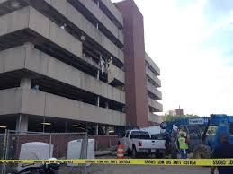 uab parking deck 4 car overturns crashes through parking deck barrier lands on