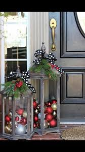 10 Outdoor Christmas Decorations That Are Simply Magical Give Your Front Door The City Glam You Love By Filling Lanterns With Shiny Ornaments And Adorning