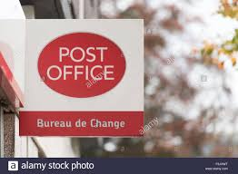 bureau de changes a post office sign for a store with a currency exchange for travel