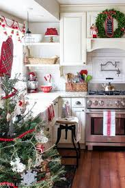 Farmhouse Style Kitchen With Red Accents And Boxwood Wreaths As