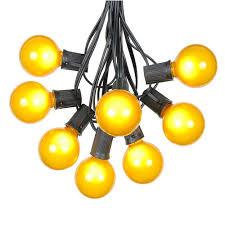 yellow satin g50 globe outdoor string light set on black wire