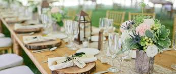 Rustic Country Wedding Reception Decorations With Small Flowers On Long Table Also Chairs Plus Glass Lanterns