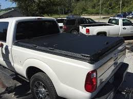 A Heavy Duty Tonneau Cover On A Ford Super Duty | A Rugged B… | Flickr Truck Bed Covers Northwest Accsories Portland Or Rugged Hard Folding Tonneau Cover Autoaccsoriesgaragecom Used 02 09 Dodge Ram Hard Shell Fiberglass Tonneau Cover For Short 052015 Toyota Tacoma 61ft Standard Rollup Vinyl Amazoncom Tonno Pro 42506 Fold Black Trifold Heavy Duty Diamondback Hd Xmate Trifold Works With 2015 Advantage Surefit Snap Weathertech Roll Up Tyger Auto Tgbc3d1015 Trifold Whats The Difference In Cheap Vs More Expensive
