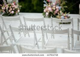 White Garden Chairs Stand In A Ray Waiting For The Wedding Ceremony