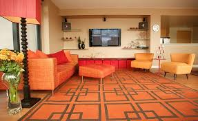 View In Gallery Bright Orange And The Geometric Rug Usher Retro Vibe