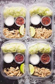 Meal Prep Containers With Lettuce Black Lentils Chicken Breast Sour Cream And