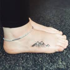 Mountain Tattoo On The Right Foot
