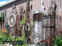 Rustic Garden Art Wonderful Display Of Eclectic On A Fence At Salvage Yard