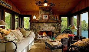 View In Gallery Custom Stone Fireplace Elevates The Style Quotient Of Beautiful Rustic Sunroom Design Lands