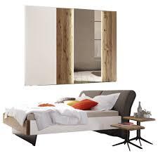 thielemeyer feel schlafzimmer ausführung lack weiß mit absetzungen wildeiche massivholz mit komfort liegenbett und schwebetürenschrank