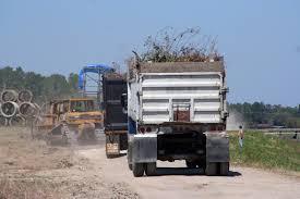 100 Texas Trucks Hauling Hurricane Debris In FEMAgov