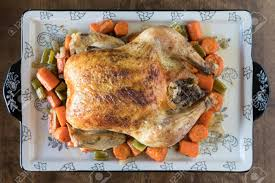 100 Golden Crust Roasted Chicken With A Golden Crust And Vegetables On A Wooden