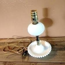 milk glass table lamp – love base