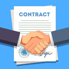 Business Man Shaking Hands Over A Signed Contract