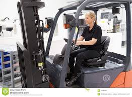 100 Female Truck Driver Fork Lift Working In Factory Stock Image