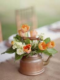 Though We Love Glass Vases And Mason Jars Creative Containers Like Watering Cans Copper