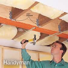how to install a load bearing wall beam family handyman