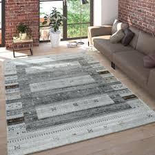 wohnzimmer teppich bordüre design streifen symbole