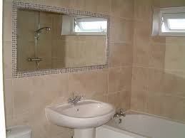 classy mosaic tile around bathroom mirror also home decoration
