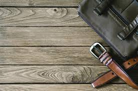 Download Brown Leather Belt And Bag On The Wooden Table Top View With C Stock