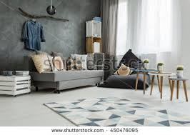 New Apartment Interior In Grey With Sofa Modern Pouf Small Table Two Chairs
